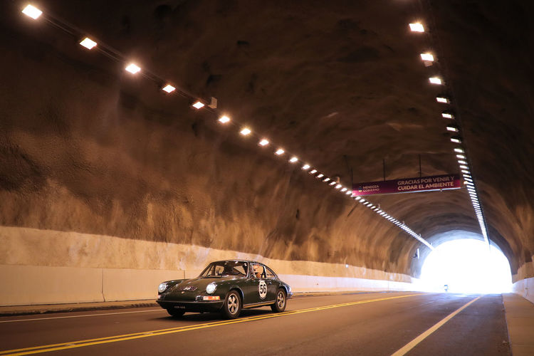 Illuminated Transportation Tunnel Architecture Car Motor Vehicle Road Land Vehicle Lighting Equipment Indoors  No People Mode Of Transportation Built Structure Direction Sign The Way Forward Ceiling Arch Light on the move Light At The End Of The Tunnel