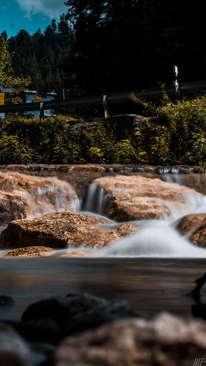 Water Motion Long Exposure Nature Beauty In Nature Scenics - Nature Plant Flowing Water Blurred Motion Tree No People Land Waterfall Flowing Rock Outdoors Day Sky Solid Power In Nature