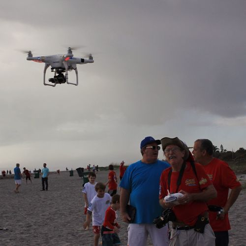 Drone operator Surfing Santas Cocoa Beach, Florida Drone  Beach Photography Flying Air Vehicle Drone Flying Drone  Drone Photography Beach Real People Leisure Activity