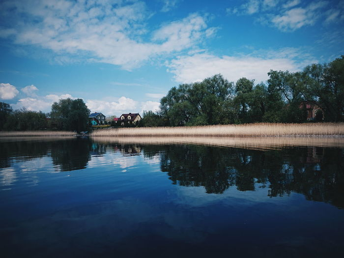 Reflection. Nature Beauty In Nature EyeEm Best Shots EyeEm Best Edits EyeEm Best Shots - Nature Landscape Light Springtime Water Tree Lake Reflection Sky Cloud - Sky Reflection Lake Standing Water Symmetry Calm Countryside Scenics Water Surface Lakeside