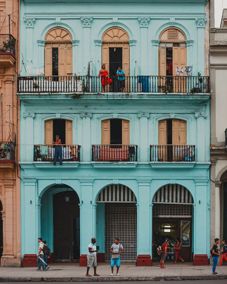 People walking on building in city