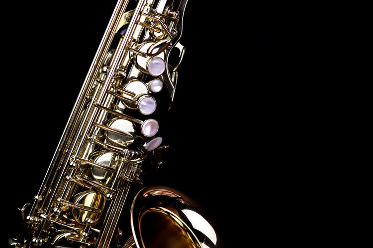 Music Instrument Alto Saxophone, Saxophone Isolated on black Musical Instrument Music Arts Culture And Entertainment Studio Shot Black Background Indoors  Wind Instrument Copy Space Musical Equipment Brass Instrument  Metal Saxophone Close-up No People Shiny Cut Out Performance Single Object Brass Gold Colored