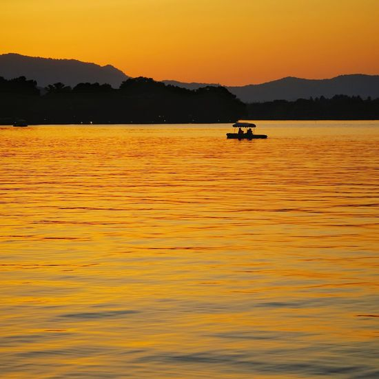 Sunset Lake Silhouette Outdoors Reflection Water Nature Yellow Scenics Landscape Mountain Tranquility FUJIFILM X-T10 China View Light And Shadow West Lake, Hangzhou Hangzhou,China Lake View Vacations Warm Glow Travel Mountain Range Summer Floating On Water Travel Destinations