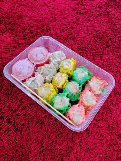 High angle view of multi colored candies in container