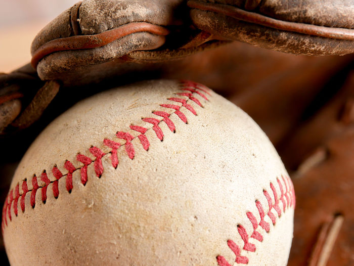 Close-up of ball and gloves