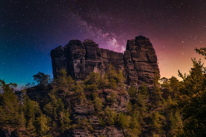 Sandstone rock formation the locomotive in german-saxon switzerland at night. astro composition