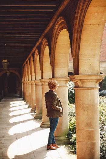 Full Length Of Woman At Corridor Of Church