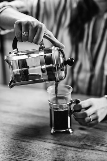 French Press Coffee Coffee French Press Female Woman Cafe Home Drink Young Girl Cup Glass One Person person Enjoy People Caucasian Lifestyle Caffeine Indoors  Holding Aroma Black And White Break Drinking Coffee Cup Hand Food And Drink Table Coffee - Drink Unrecognizable Person Pouring