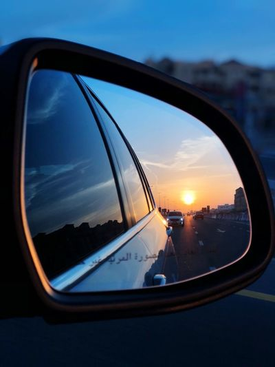 Reflection of sky on side-view mirror