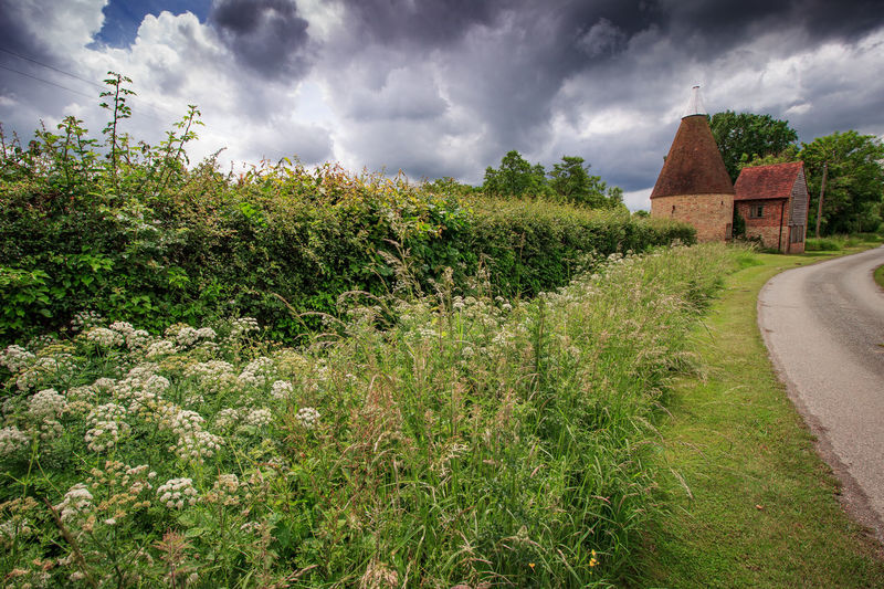 Oast House,Garden of England, Kent, England. Plant Nature No People Built Structure Architecture Building Exterior Outdoors Building Hops Beer Brewing Travel Destinations Tourism Caravan Rural Scene Countryside EyeEm Gallery Vivid International Getty Images Architecture Iconic Buildings Cloud - Sky Sky Growth Land Grass Day Field Green Color House Tree Landscape Beauty In Nature