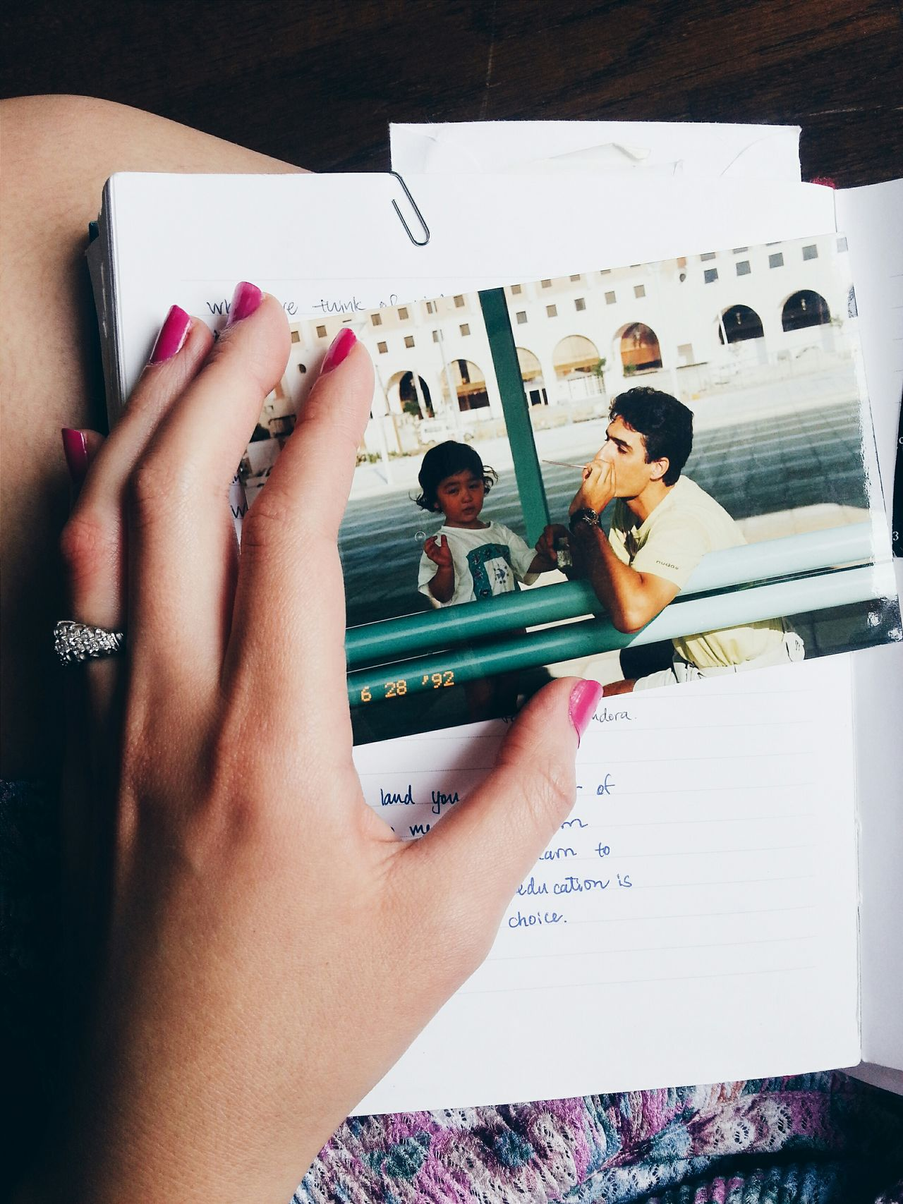 Cropped image of woman touching photograph