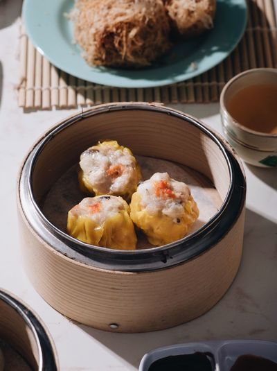 Siew mai Dimsum Food Food And Drink Dumpling  Asian Food Ready-to-eat Freshness Indoors  Still Life Healthy Eating Bowl Chinese Dumpling High Angle View Wellbeing Table Dim Sum Container No People Close-up Chinese Food Serving Size