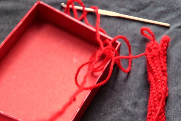 High angle view of red tied up on rope