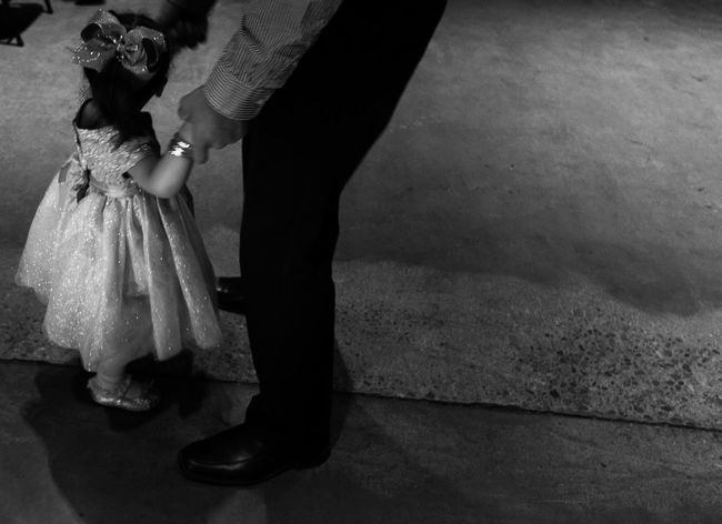 Father daughter dance. Afterparty Balance Blackandwhite Cropped Dressupparty Fancydress Fatherdaughterdance Holding Human Finger Human Hand Human Leg InTheDark Leisure Activity Lifestyles Monochrome Part Of Photography Real People Reception Hall Slowdance Tucson Arizona  Unrecognizable Person