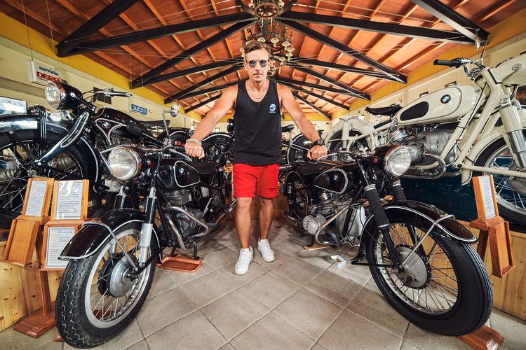 Full length portrait of man cycling