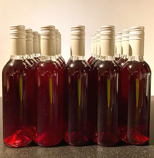 Close-up of wine bottles in glass