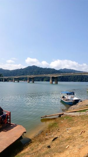 Lake of Banding in Malaysia Sky Day Sunny Beach Outdoors Tranquility Water Mountain Cloud - Sky Architecture Nature No People Sand Built Structure Travel Destinations Sea Scenics Landscape Nautical Vessel Building Exterior boat Holiday season tourism