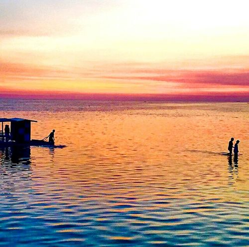 Warm hearts and warm sunset. Sunset Reflection Water Outdoors Sea Beauty In Nature Tranquility Nature Multi Colored Scenics Sky Horizon Over Water Travel Destinations Red Vacations People Full Length One Person Day