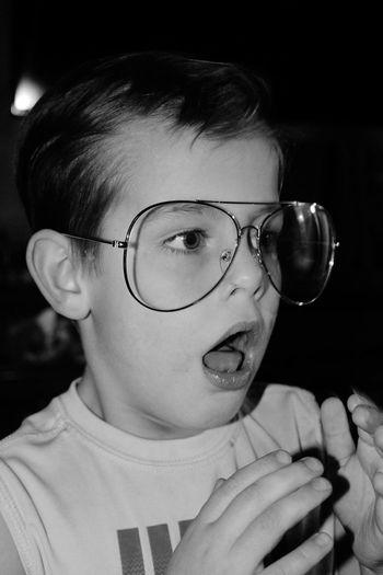Close-up of cute boy wearing huge eyeglasses