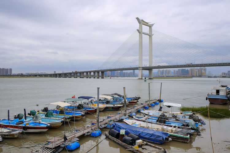17.62° Transportation Nautical Vessel Water Mode Of Transportation Moored Sky Cloud - Sky Architecture Harbor Built Structure Nature Bridge Connection No People Bridge - Man Made Structure Pier Day Building Exterior Sea Outdoors Sailboat Fishing Industry Port