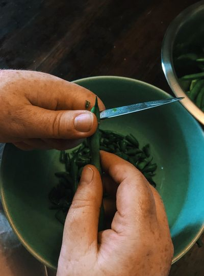 Cropped Hands Cutting Green Bean
