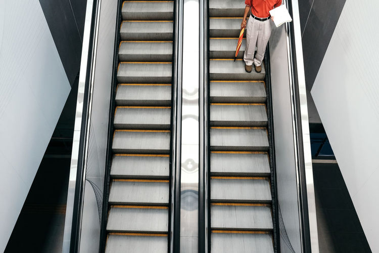 Staircase Steps And Staircases Railing Low Section One Person Architecture Indoors  Real People Low Angle View Lifestyles Pattern Escalator Convenience Metal Women Human Leg Built Structure Moving Up Modern Moving Walkway  Technology