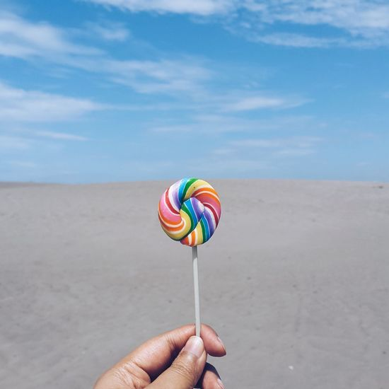 Holding Sky Multi Colored Sand Beach Colorful Travel Destinations Vacations Tourism Cloud - Sky Outdoors Personal Perspective Human Finger Day Blue Summer Candy Lollipop INDONESIA Jogjakarta Parangkusumo Minimalism Minimal Minimalist TakeoverContrast