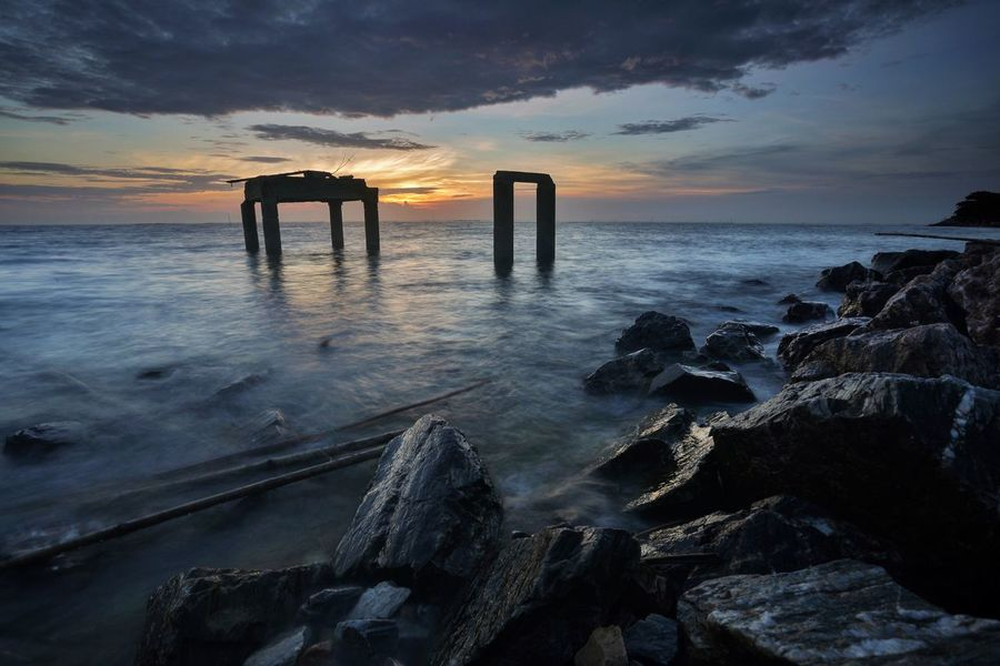 Sea Sunset Nature Horizon Over Water Sky Water Cloud - Sky Scenics Beauty In Nature Tranquil Scene Tranquility Outdoors Beach No People Built Structure Architecture Day