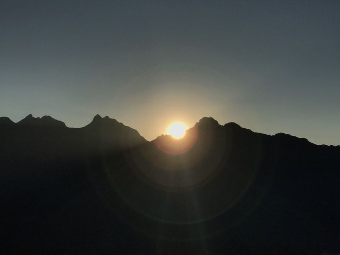 Sun Silhouette Mountain Nature Sunset No People Scenics Tranquility Clear Sky Beauty In Nature Sunlight Sky Outdoors