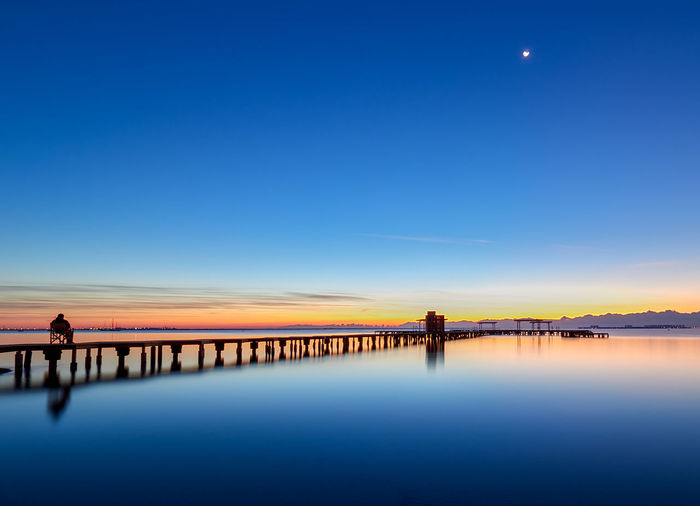 Amanecer en la playa Sky Water Scenics - Nature Beauty In Nature Moon Blue Tranquility Architecture Built Structure Tranquil Scene Reflection Nature Waterfront Pier Bridge Idyllic Outdoors Sunrise Clouds Horizon Orange Sunlight Sun Morning Scenery