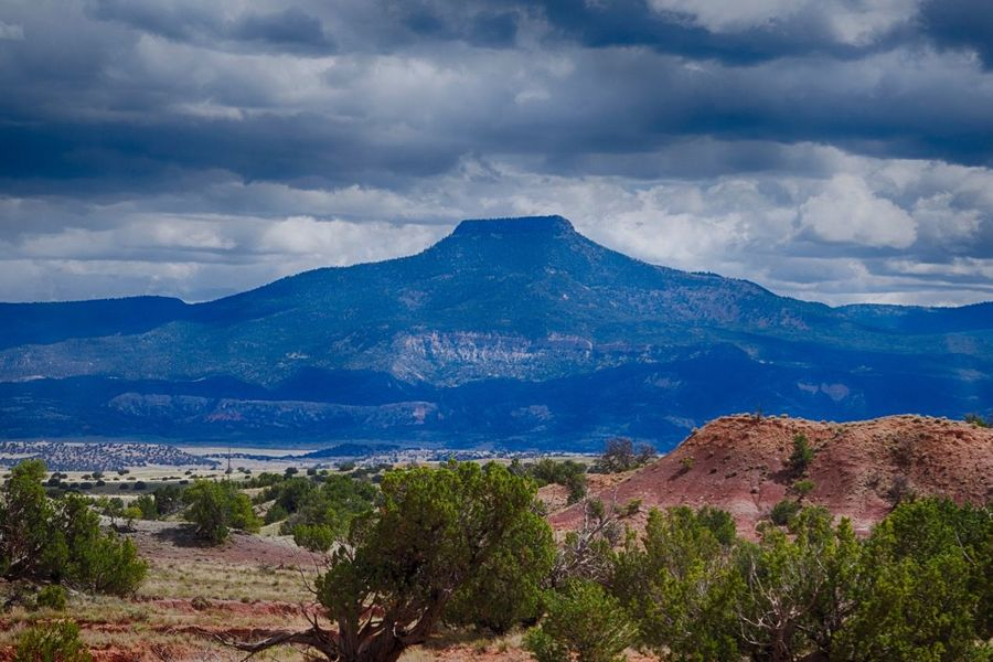 Ghost Ranch, New Mexico, USA Beauty In Nature Cloud - Sky Day Georgia Okeefe Landscape Mountain Mountain Range Nature No People Outdoors Remote Scenics Sky Tranquil Scene Tranquility Travel Destinations Tree