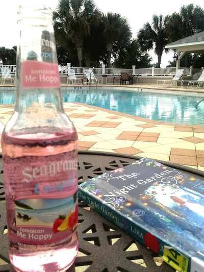 Life is good Summertime Colorful Drink Pool Poolside Pink Pink Drink Blue Blue Pool Warm Weather Library Book Library Swimming Lounging Relaxing Florida Florida Life