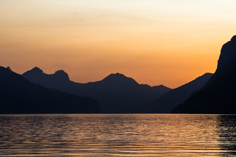 Simple sunset Orange Sky Sunset Silhouettes Sunset_collection WeekOnEyeEm Beauty In Nature Lake Mountain Nature Orange Color Silhouette Sky Sunset Switzerland Walensee Walensee Switzerland Lake Water Waterfront The Great Outdoors - 2018 EyeEm Awards The Traveler - 2018 EyeEm Awards