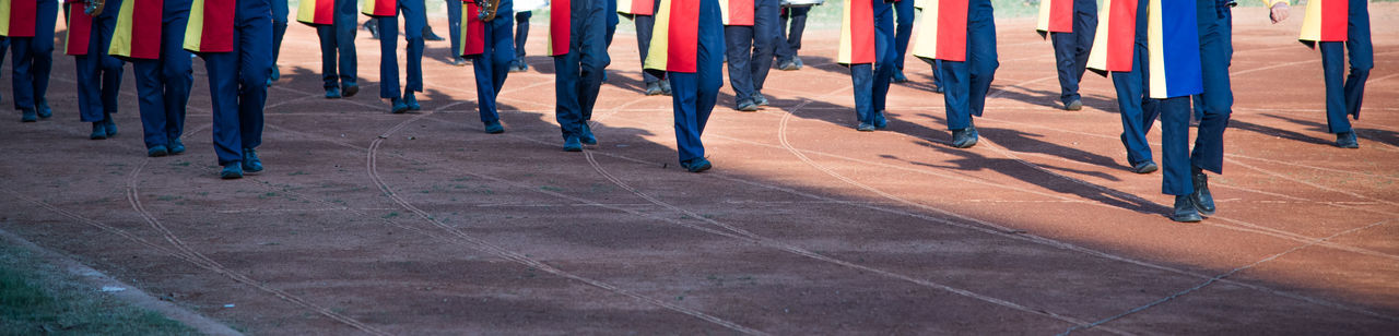 Low section of military people marching on track