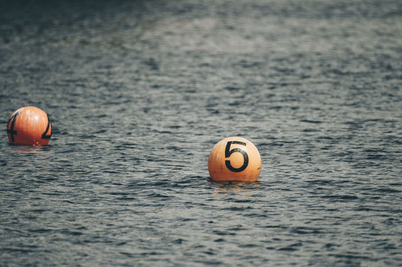 Buoys floating on water in sea