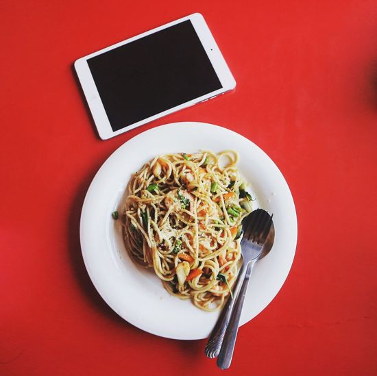 Pasta Plate Italian Food Wireless Technology Food And Drink Noodles Food Communication Spaghetti Table Technology Serving Size No People Ready-to-eat Indoors  Freshness Red Background Healthy Eating Global Communications Close-up