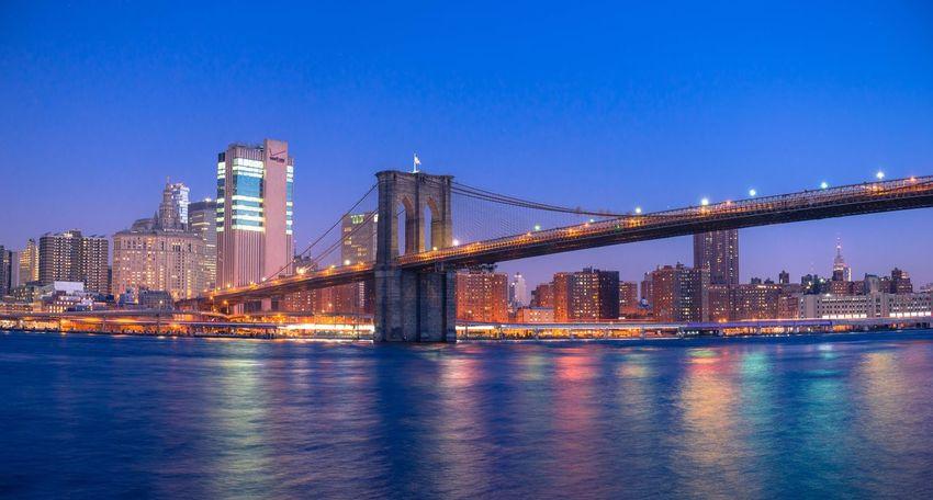 USA New York Brooklyn Bridge / New York Skyscraper City Urban Skyline River Cityscape Travel Destinations Building Exterior Waterfront Tourism Transportation Water Travel Downtown District