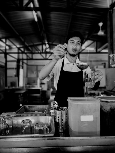 A tea 🍵 maker day story Tea Shop Photographer Photo Photography monochrome photography Monochrome Teastall Street Life #survival EyeEmNewHere Working Occupation Factory Business Finance And Industry Skill  Men Preparation  Chef Commercial Kitchen Baker - Occupation
