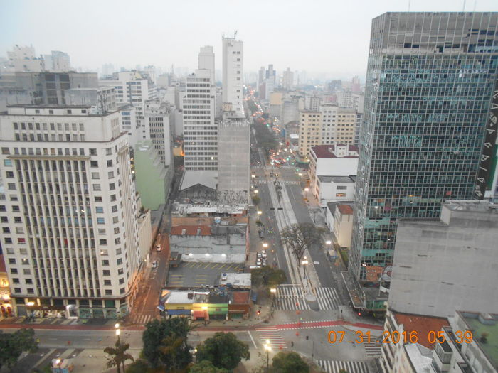 BEFORE PHOTO. Building Collapse: Inner City Calamity in downtown São Paulo at Largo do Paissandú; 3 am May 1, 2018. The abandoned former Federal Police steel and glass skyscraper, which had been invaded by street people, imploded this early morning May 1, 2018 and the neighboring building has caught on fire as well. This photo was taken on July 31, 2016 at Largo do Paissandú. On the right side of the photo is a BEFORE photo of the building that was engulfed in flames which subsequently imploded; the building inn front of it in the forefront of the photo also caught on fire. Before Photo Of Event Related To May 1, 2018 Building Fire Current Events Largo Do Paissandu May 1, 2018 Skyline Susan A. Case Sabir Unretouched Photography Building Exterior Built Structure City Life Cityscape Dated Photograph Downtown São Paulo High Angle View No People Skyscraper Urban Photography