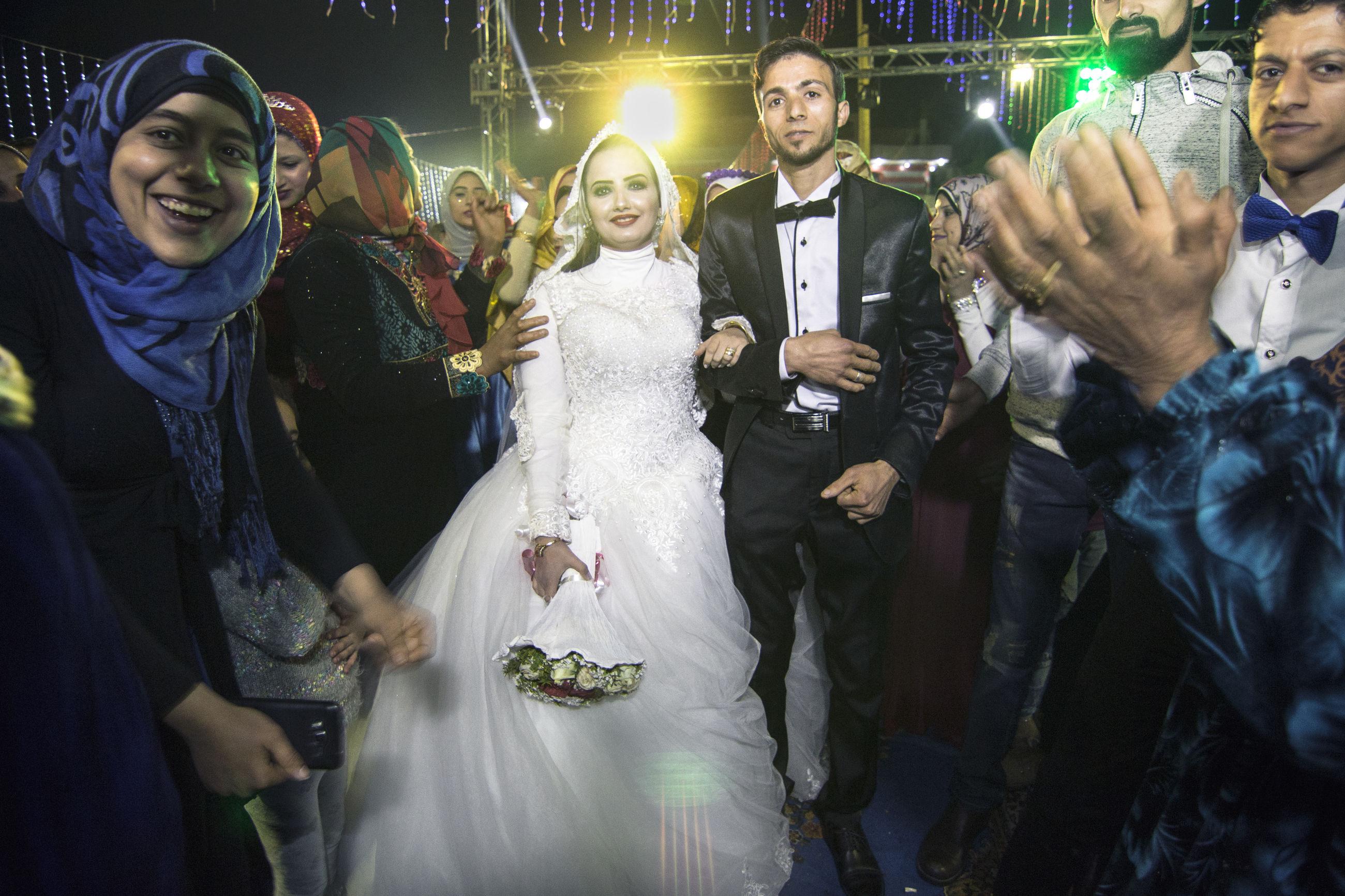 wedding, bride, celebration, togetherness, men, love, wedding dress, bridegroom, tuxedo, life events, medium group of people, night, well-dressed, women, illuminated, young adult, standing, bonding, young women, indoors, adult, people