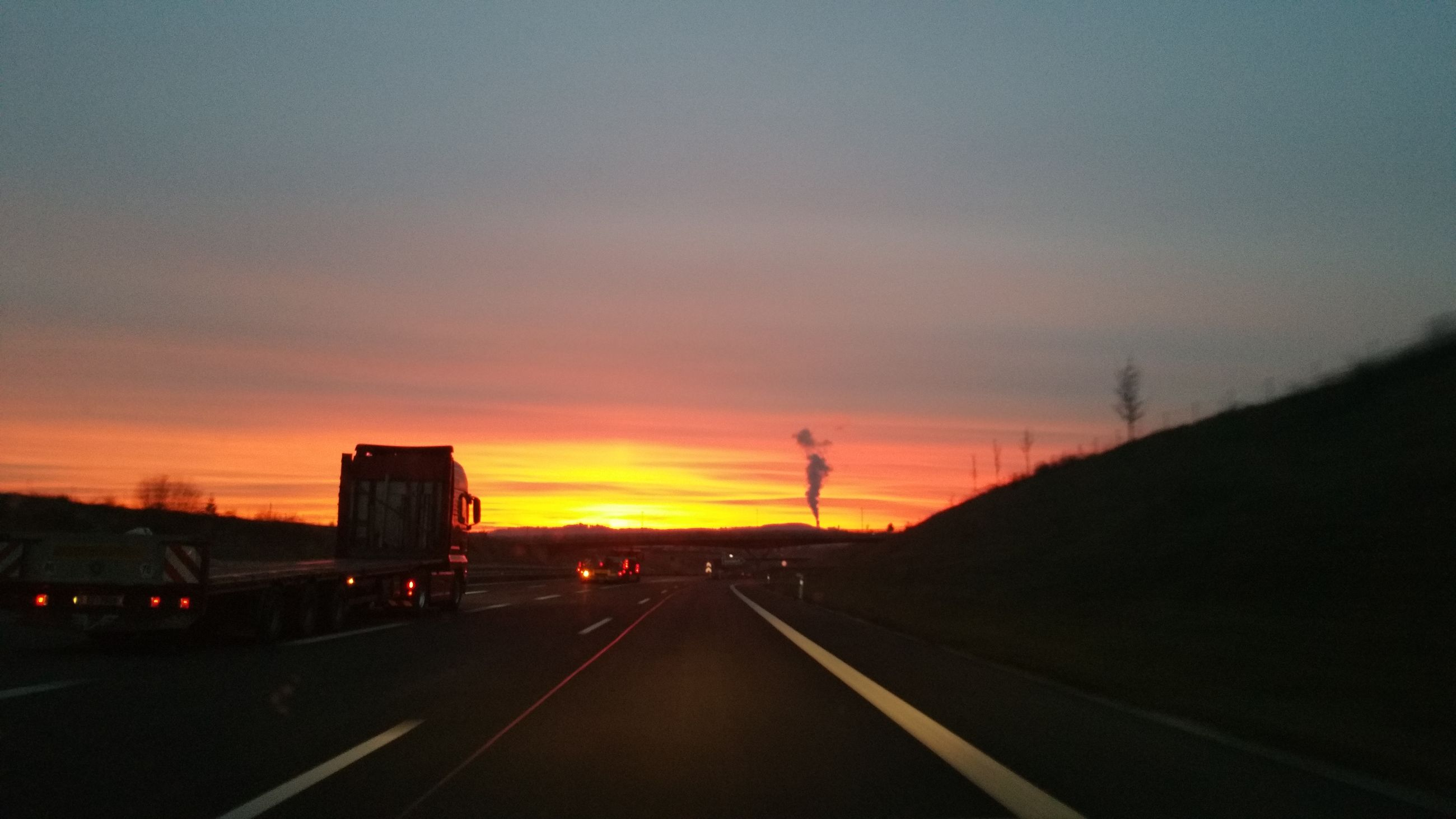 transportation, road, sunset, the way forward, car, highway, mode of transport, sky, land vehicle, outdoors, nature, one person, people, day