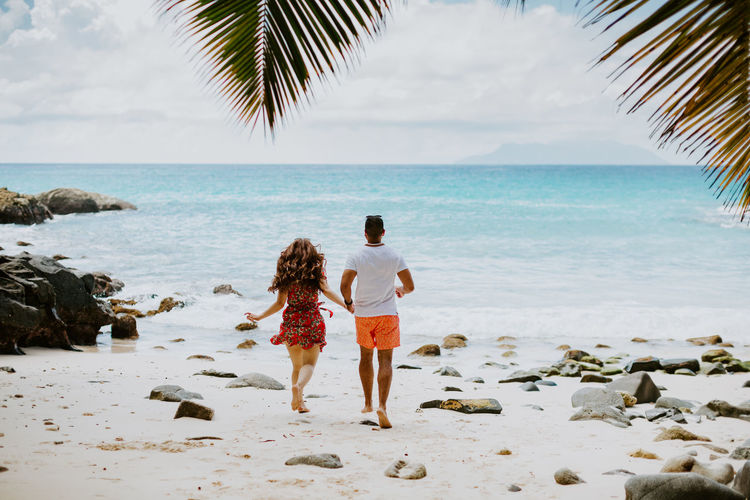 couple travel on beach of tropical island. Lovely couple relax on beach with white sand in exotic island. Couple Couple - Relationship Beach Summer Sun Togetherness Love Resort Island Tropical Ocean Sea Relaxing Travel Travel Destinations Leisure Activity Lifestyles Exotic Seychelles Vacations Honeymoon Fun Happiness EyeEm Best Shots