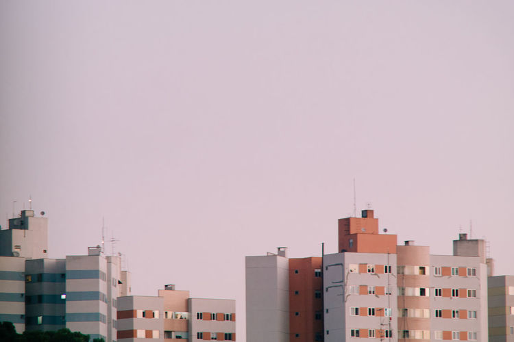 Exterior of buildings in city against clear sky
