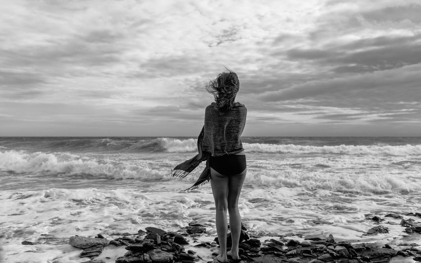 Here Beach Beauty In Nature Cloud - Sky Day Full Length Horizon Over Water Leisure Activity Lifestyles Nature One Person Outdoors Real People Rear View Scenics Sea Sky Standing The Portraitist - 2017 EyeEm Awards Water Wave Women Young Adult Young Women