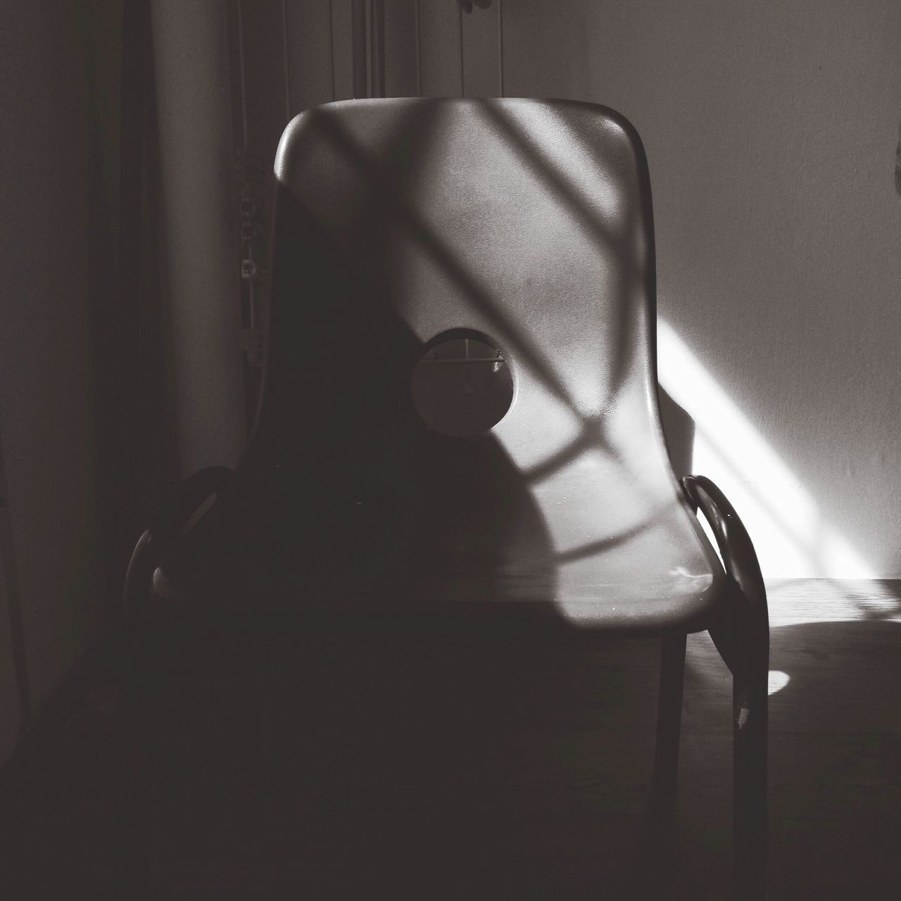 Sunlight Falling On Empty Chair At Home