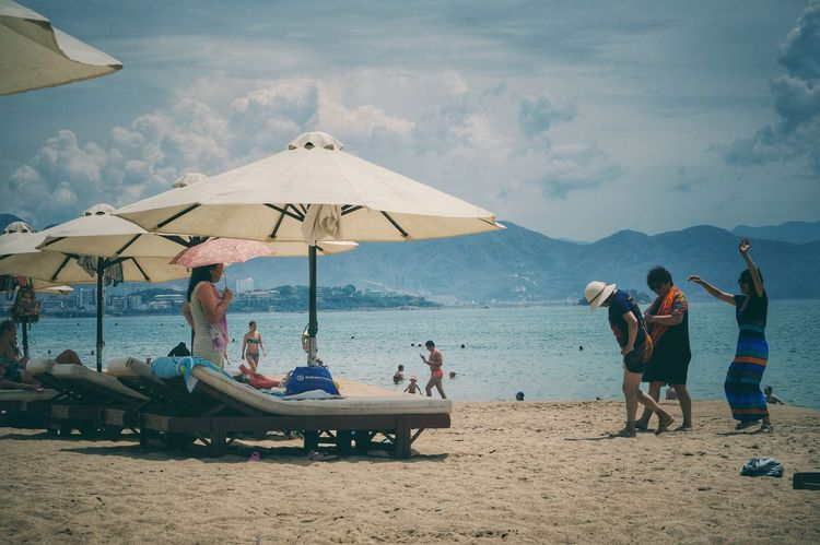 Vietnam beach Beach Sky Water Sand Sea Real People Nature Cloud - Sky Men Leisure Activity Large Group Of People Day Lifestyles Beauty In Nature Outdoors Enjoyment Horizon Over Water Nautical Vessel Women Vacations