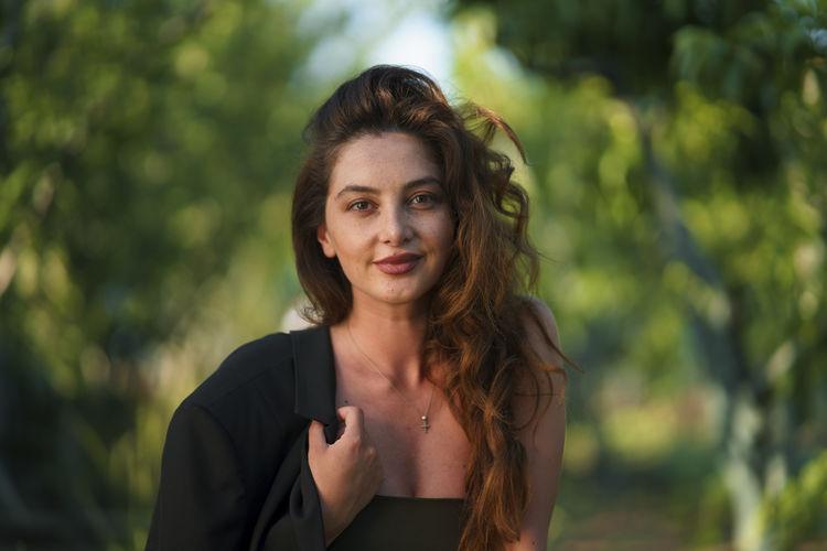 Portrait of smiling woman at park