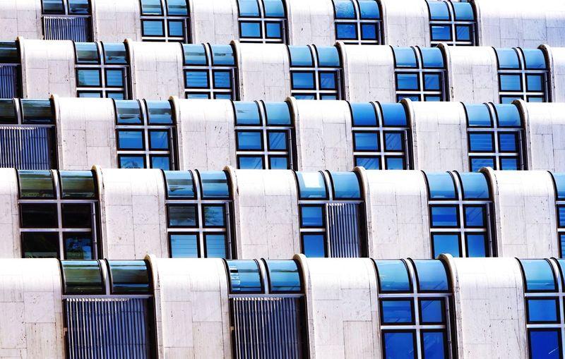 Full frame shot of white fence against blue sky