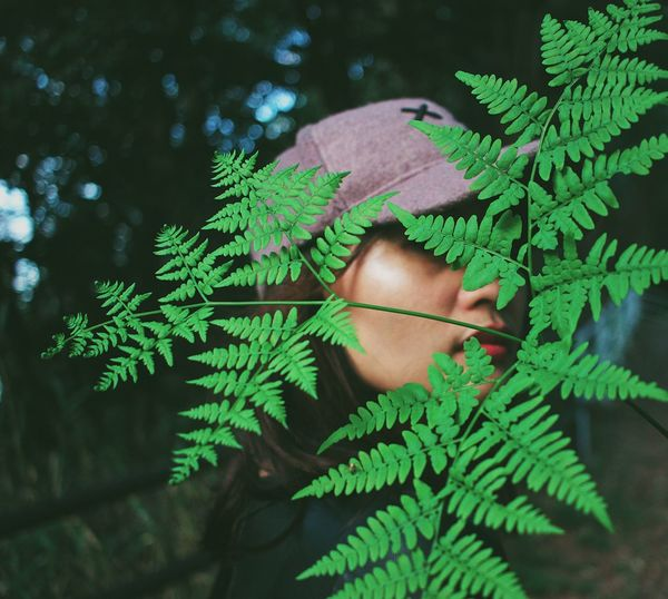 Loving green makes you think how important is your life. Selfietime Bokeh Bokeh Photography Photography Naturelovers Nature_collection Nature Photography Power In Nature Cap Fern Green Color One Person Leaf Plant Part Plant Human Body Part Real People Nature Growth Day Lifestyles Unrecognizable Person Close-up Body Part Leisure Activity Tree High Angle View Leaves Personal Perspective Outdoors