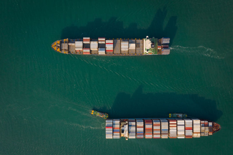 Aerial top view from drone, container ship or cargo shipping business logistic import and export